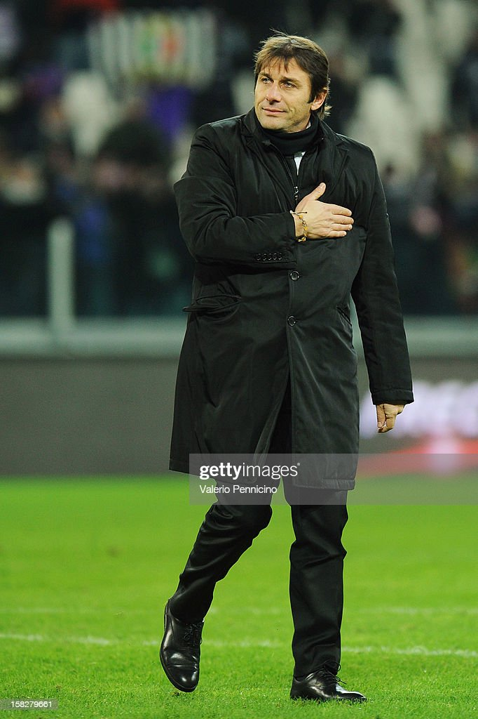Juventus FC head coach Antonio Conte salutes the crowd at the end of the TIM Cup match between Juventus FC and Cagliari Calcio at Juventus Arena on December 12, 2012 in Turin, Italy.