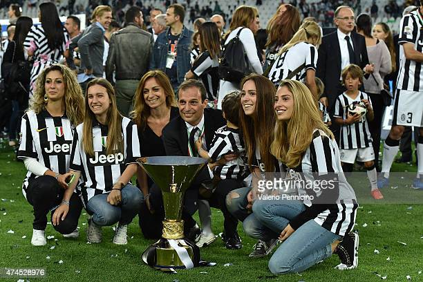 Juventus FC head coach Massimiliano Allegri and family celebrate with the Serie A Trophy at the end of the Serie A match between Juventus FC and SSC...