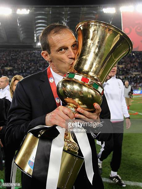 Juventus FC head coach Massimiliano Allegri celebrates with the trophy after winning the TIM Cup final match against AC Milan at Stadio Olimpico on...