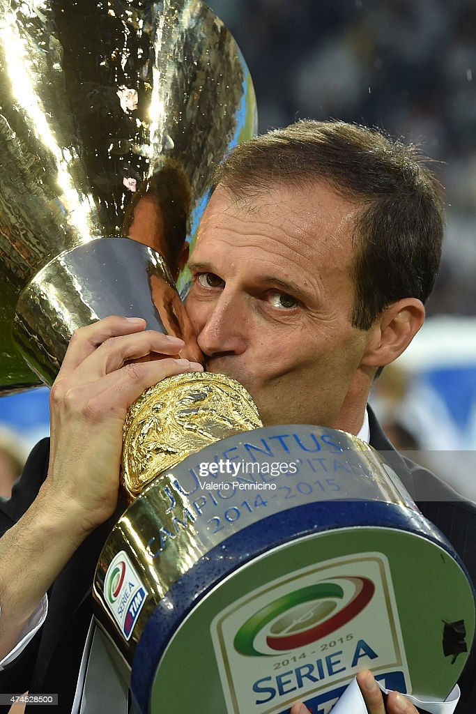 Juventus FC head coach <a gi-track='captionPersonalityLinkClicked' href=/galleries/search?phrase=Massimiliano+Allegri&family=editorial&specificpeople=3470667 ng-click='$event.stopPropagation()'>Massimiliano Allegri</a> celebrates with the Serie A Trophy at the end of the Serie A match between Juventus FC and SSC Napoli at Juventus Arena on May 23, 2015 in Turin, Italy.