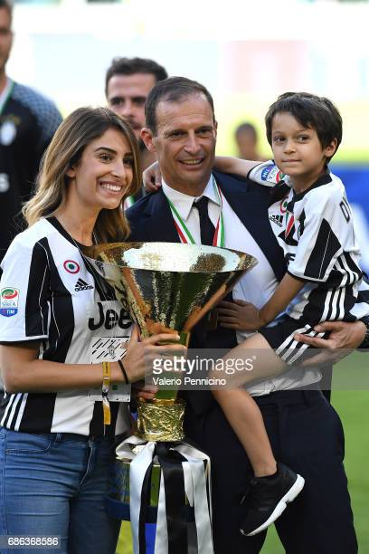 Juventus FC head coach Massimiliano Allegri celebrates with the trophy after the beating FC Crotone 30 to win the Serie A Championships at the end of...