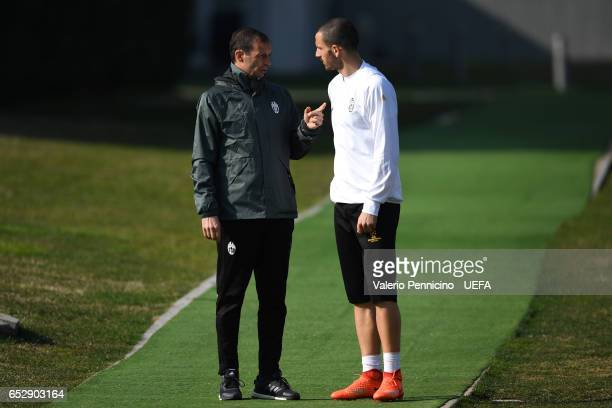 Juventus FC head coach Massimiliano Allegri talks with Leonardo Bonucci during a training session ahead of the UEFA Champions League Round of 16...