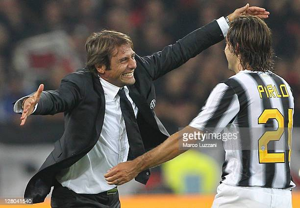 Juventus FC manager Antonio Conte celebrates the victory with Andrea Pirlo at the end of the Serie A match between Juventus FC and AC Milan on...
