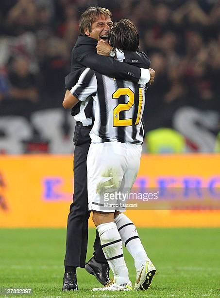Juventus FC manager Antonio Conte celebrates vctory with Andrea Pirlo at the end the Serie A match between Juventus FC and AC Milan on October 2 2011...