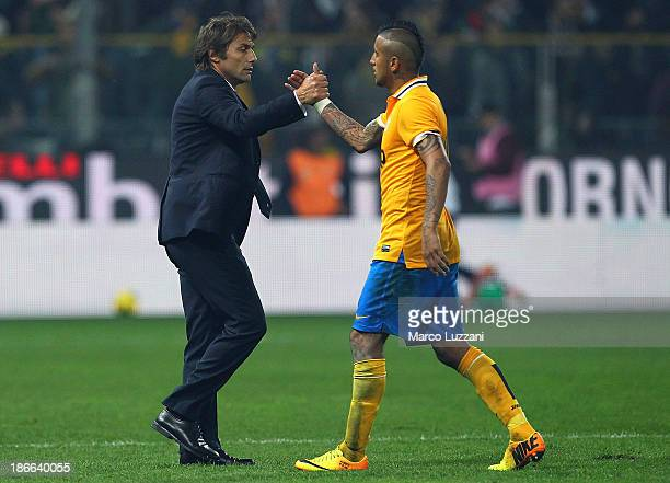 Juventus FC manager Antonio Conte shakes hands with Arturo Vidal of Juventus at the end of the Serie A match between Parma FC and Juventus at Stadio...