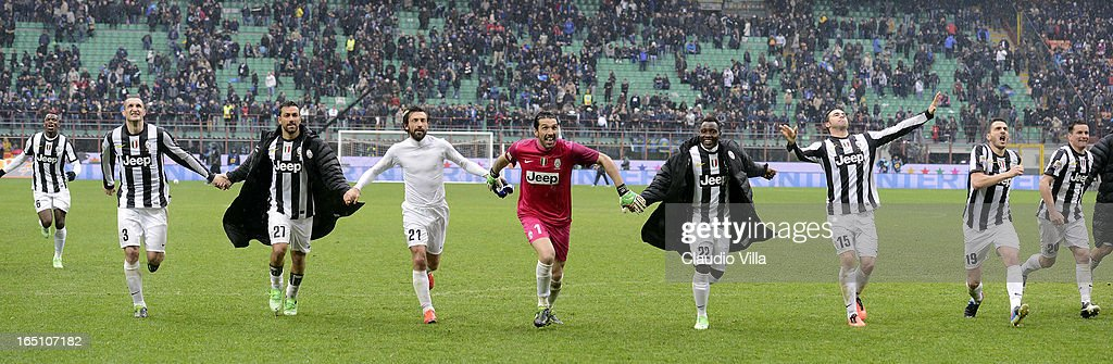Juventus FC players celebrate victory at the end of the Serie A match between FC Internazionale Milano and Juventus FC at San Siro Stadium on March 30, 2013 in Milan, Italy.