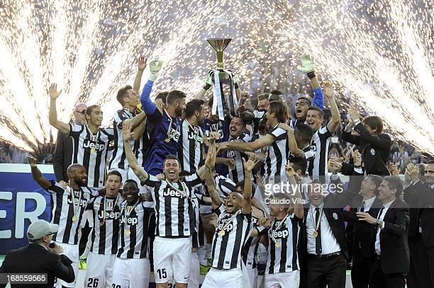 Juventus FC players celebrate with the Serie A trophy after the Serie A match between Juventus and Cagliari Calcio at Juventus Arena on May 11 2013...