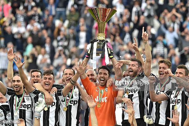 Juventus FC players celebrate with the trophy after the Serie A match between Juventus FC and UC Sampdoria at Juventus Arena on May 14 2016 in Turin...