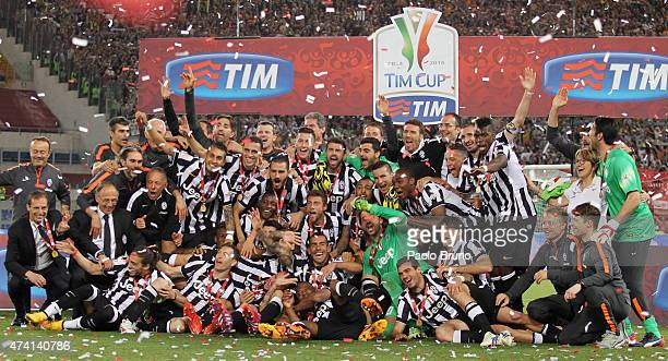 Juventus FC players celebrate with the trophy after winning the TIM Cup final match against SS Lazio at Olimpico Stadium on May 20 2015 in Rome Italy