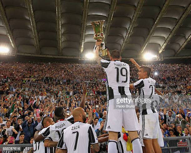 Juventus FC players celebrate with the trophy after winning the TIM Cup final match against AC Milan at Stadio Olimpico on May 21 2016 in Rome Italy