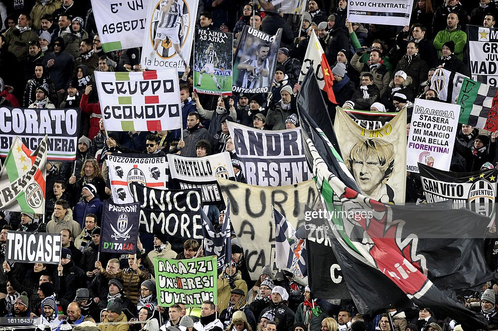 Juventus FC supporters hold banners aloft during the Serie A match between Juventus FC and ACF Fiorentina at Juventus Arena on February 9, 2013 in Turin, Italy.