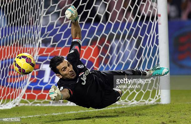 Juventus FC's Italian goalkeeper and captain Gianluigi Buffon dives to try and save a penalty shot during the Italian Super Cup against Napoli at the...