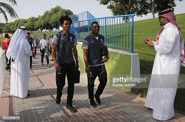 Juventus FC's players Juan Cadrado and Moise Kean arrive for a training session in Doha on December 21 two days before the Italian Super Cup final...