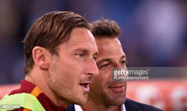 Juventus former player Alessandro Del Piero stands with Roma's forward from Italy Francesco Totti during the Italian Serie A football match Roma vs...