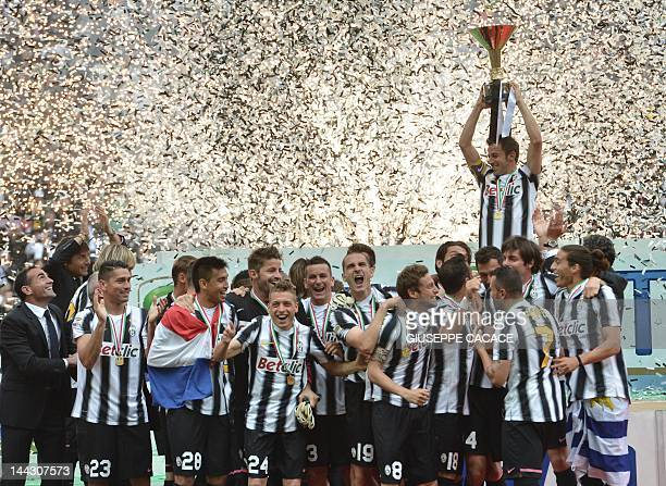 Juventus' forward Alessandro Del Piero and team mates celebrate their Italian Serie A football trophy the Scudetto during a ceremony after their...