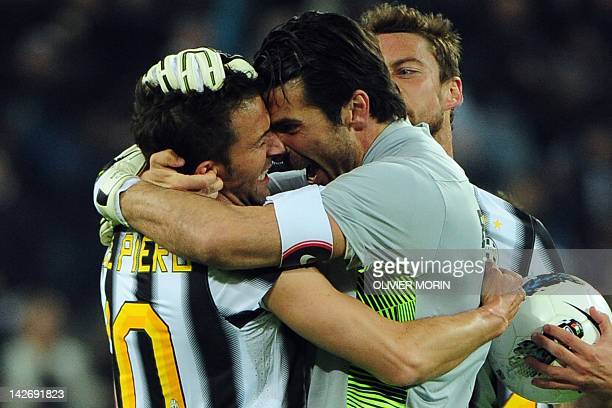 Juventus' forward Alessandro Del Piero celebrates after scoring with teammate goalkeeper Gianluigi Buffon during the Italian Serie A football match...