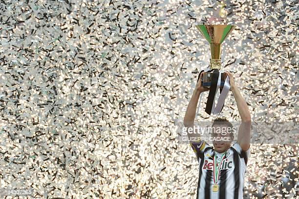 Juventus' forward Alessandro Del Piero celebrates with his team winning the Italian Serie A trophy the Scudetto during a ceremony after their match...
