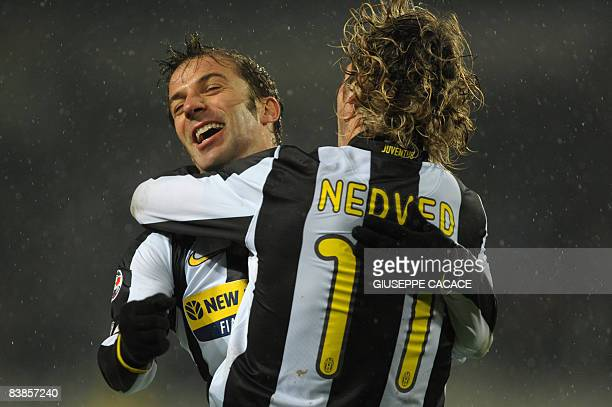 Juventus forward Alessandro Del Piero celebrates with Juventus Czech midfielder Pavel Nedved after the goal of Juventus midfielder Mauro German...