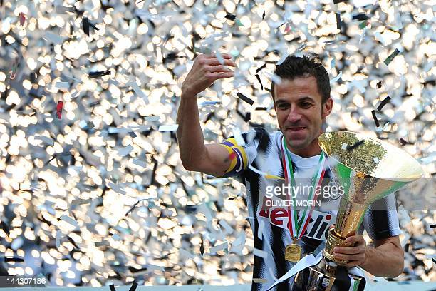 Juventus' forward Alessandro Del Piero holds the Italian Serie A trophy the Scudetto after their match against Atalanta on May 13 2012 in Juventus...