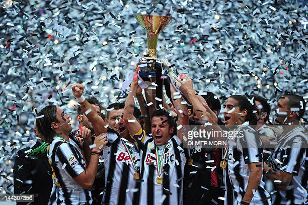 Juventus' forward Alessandro Del Piero holds the Italian Serie A football trophy the Scudetto during a ceremony after his team's match against...