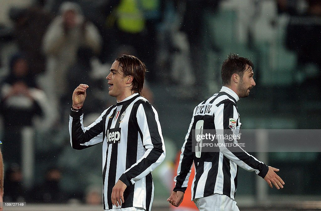 Juventus' forward Alessandro Matri (L) celebrates with teamate forward of Montenegro Mirko Vucinic after scoring against Udinese during their Serie A football match in Turin's Juventus Stadium on January 19, 2013.