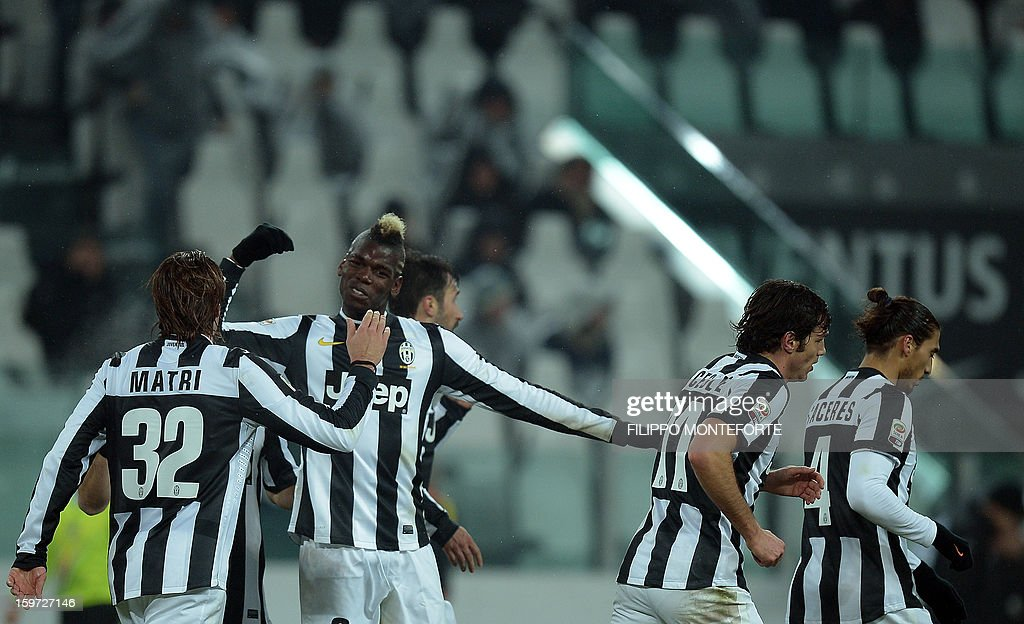 Juventus' forward Alessandro Matri (L) celebrates with teamate French midfielder Paul Pogba after scoring against Udinese during their Serie A football match in Turin's Juventus Stadium on January 19, 2013. AFP PHOTO / FILIPPO MONTEFORTE