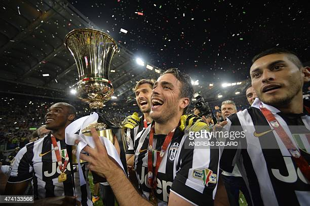 Juventus' forward Alessandro Matri celebrates with the trophy after winning 21 the Italian Tim Cup final match between Juventus and Lazio on May 20...