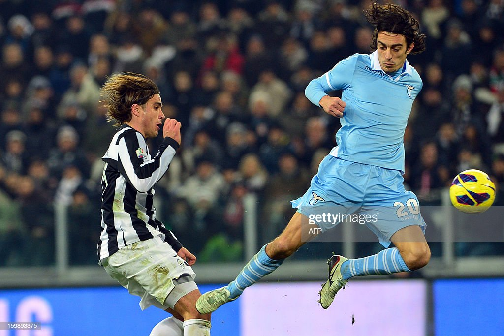 Juventus' forward Alessandro Matri (L) challanges for the ball with Lazio's defender Giuseppe Biava during their TIM CUP football match at the Juventus Stadium in Turin on January 22, 2013. AFP PHOTO / GIUSEPPE CACACE