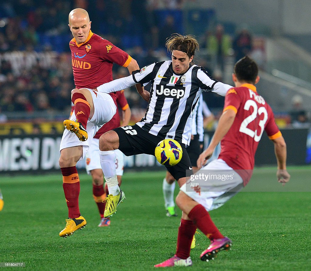Juventus' forward Alessandro Matri (C) vies with AS Roma US midfielder Michael Bradley and AS Roma Paraguayan defender Ivàn Rodrigo Piris (R) during the Italian Serie A football match between AS Roma and Juventus on February 16, 2013 at the Olympic Stadium in Rome.