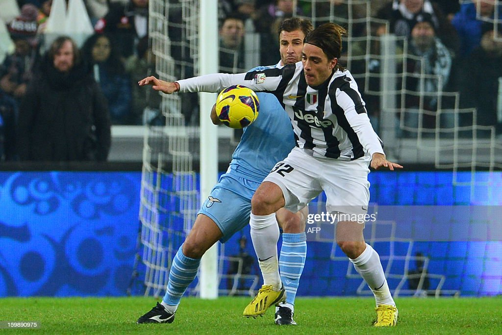 Juventus' forward Alessandro Matri (front) vies with Lazio's Albanian forward Lorik Cana during their TIM CUP football match between Juventus and Lazio at the 'Juventus Stadium' in Turin on January 22, 2013.