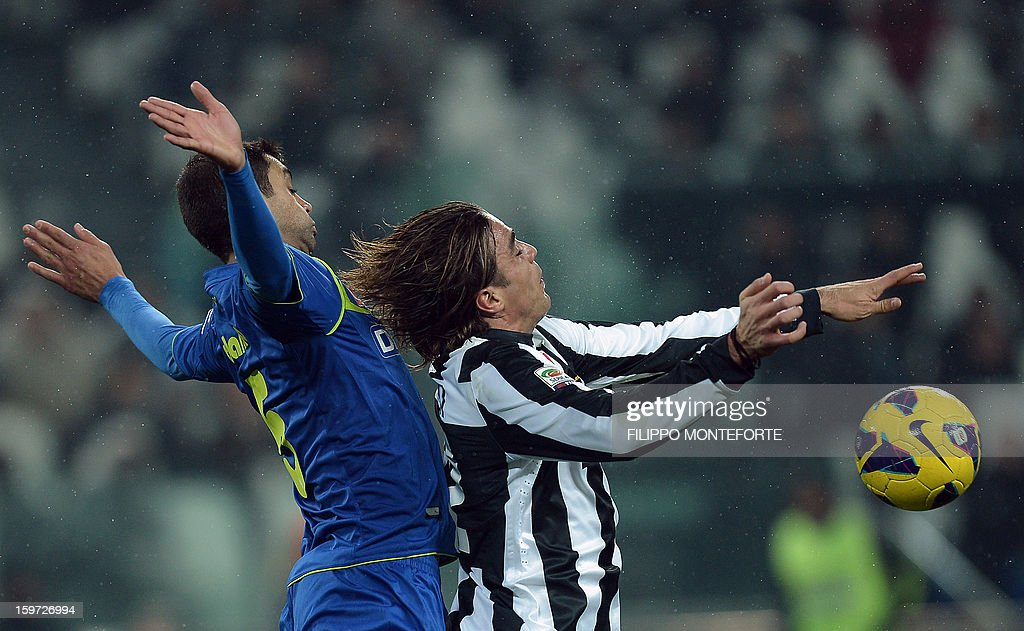 Juventus' forward Alessandro Matri (R) vies with Udinese's Brasilian defender Danilo Larangeria during their Serie A football match in Turin's Juventus Stadium on January 19, 2013. AFP PHOTO / FILIPPO MONTEFORTE