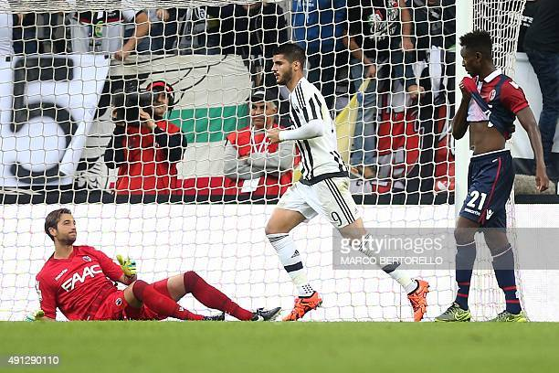Juventus' forward Alvaro Morata from Spain celebrates after scoring against Bologna's goalkeeper from Italy Antonio Mirante during the Italian Serie...