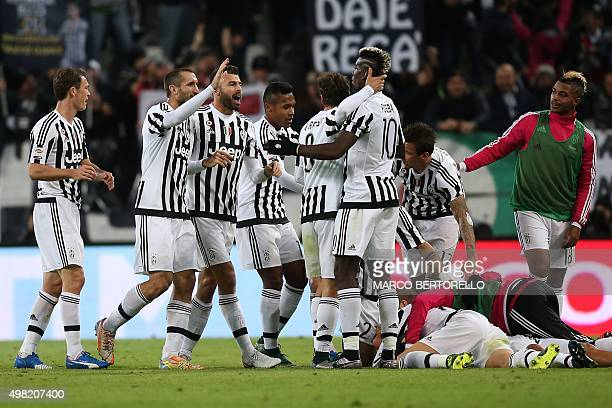 Juventus' forward Argentinian Paulo Dybala celebrates with teammates after scoring a goal during the Italian Serie A football match between Juventus...