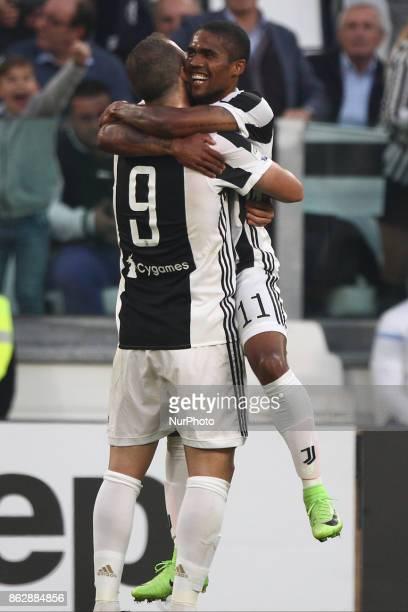 Juventus forward Douglas Costa celebrates with Juventus forward Gonzalo Higuain after scoring his goal during the Serie A football match n8 JUVENTUS...