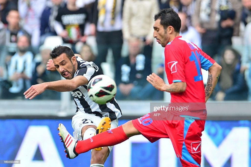 Juventus' forward Fabio Quagliarella vies with Catania's midfielder Francesco Lodi during their Serie A football match between Juventus and Catania at the 'Juventus Stadium' in Turin on March 10, 2013.