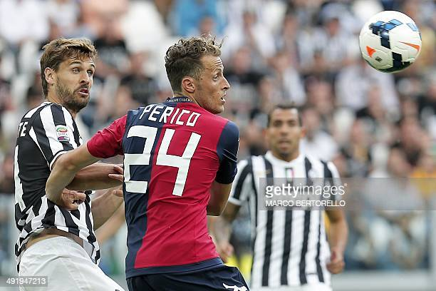 Juventus' forward Fernando Llorente fights for the ball with Cagliari's defender Gabriele Perico during the Italian Serie A football match Juventus...