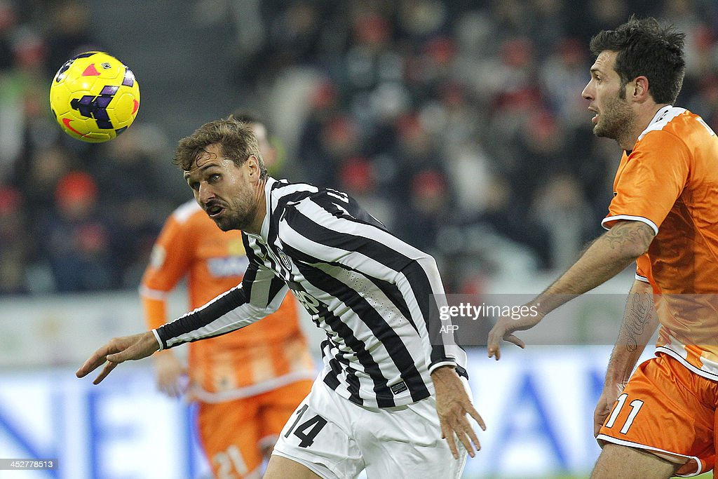 Juventus' forward Fernando Llorente fights for the ball with Udinese's defender Maurizio Domizzi during the Italian Serie A football match Juventus Vs Udinese on December 1, 2013 at Juventus Stadium in Turin.