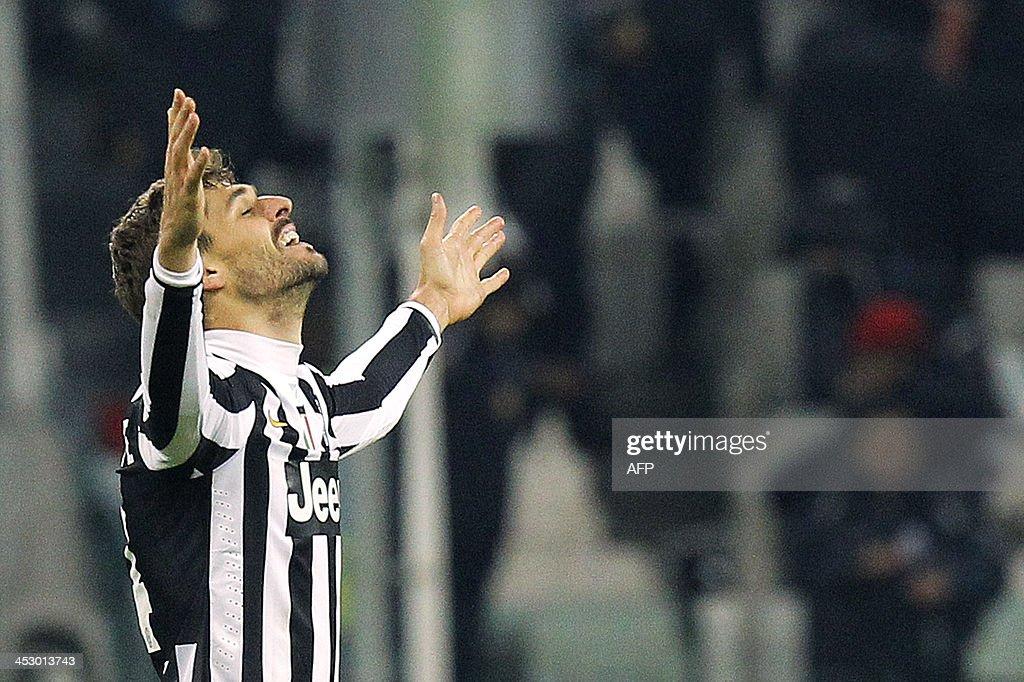 Juventus' forward Fernando Llorente jubilates at the end of the Italian Serie A football match Juventus Vs Udinese on December 1, 2013 at Juventus Stadium in Turin. AFP PHOTO / MARCO BERTORELLO