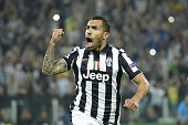 Juventus' forward from Argentina Carlos Tevez celebrates after scoring a penalty kick during the UEFA Champions League semifinal first leg football...