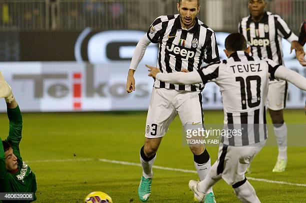 Juventus' forward from Argentina Carlos Tevez scores during the Italian Serie A football match Cagliari vs Juventus on December 18 2014 at the...