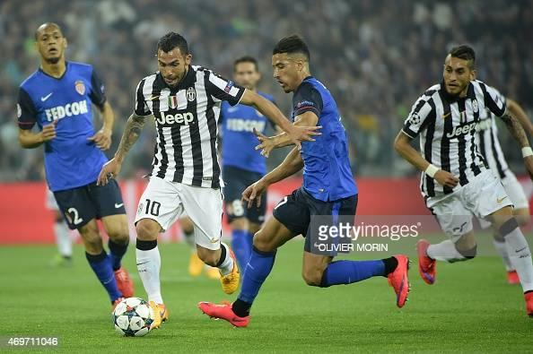 Juventus' forward from Argentina Carlos Tevez vies with Monaco's Belgian Moroccan midfielder Nabil Dirar during the UEFA Champions League quarter...