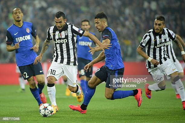 Juventus' forward from Argentina Carlos Tevez vies with Monaco's Belgian Moroccan midfielder Nabil Dirar during the UEFA Champions League quarter...