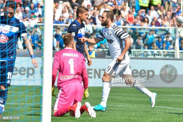 Juventus' forward from Argentina Gonzalo Gerardo Higuain celebrates after scoring against Pescara's goalkeeper Vincenzo Fiorillo during the Italian...
