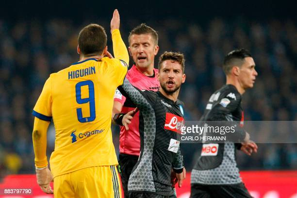Juventus' forward from Argentina Gonzalo Higuain argues with Napoli's forward from Belgium Dries Mertens and referee Daniele Orsato during the...