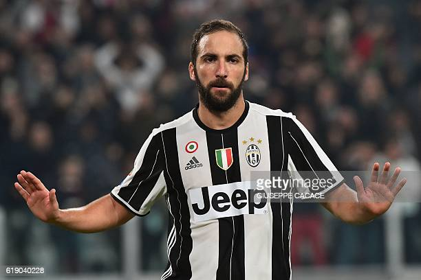 Juventus' forward from Argentina Gonzalo Higuain celebrates after scoring a goal during the Italian Serie A football match Juventus vs Napoli at...