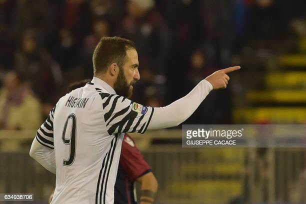 Juventus' forward from Argentina Gonzalo Higuain celebrates after scoring a goal during the Italian Serie A football match between Cagliari and...