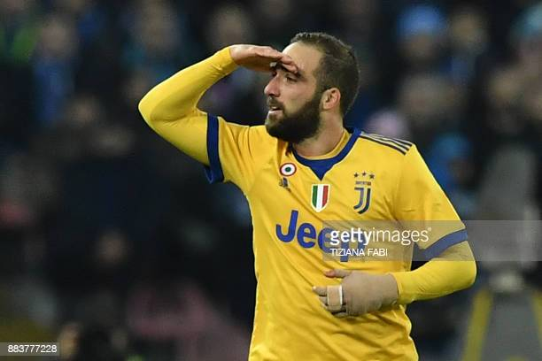 Juventus' forward from Argentina Gonzalo Higuain celebrates after scoring during the Italian Serie A football match Napoli vs Juventus on December 1...