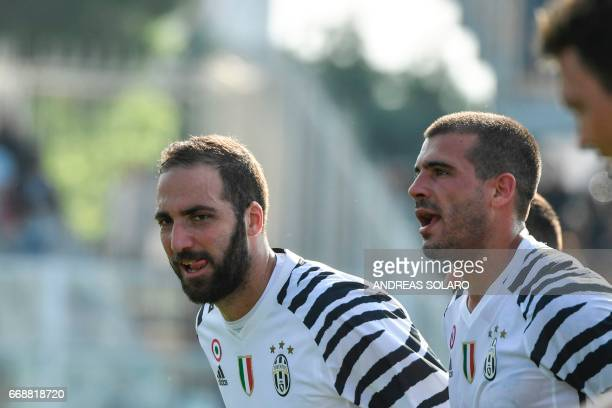Juventus' forward from Argentina Gonzalo Higuain celebrates at the end of the Italian Serie A football match Pescara versus Juventus at Adriatico's...