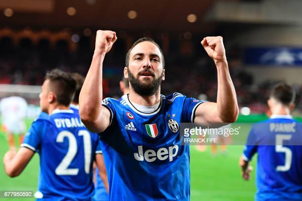 Juventus' forward from Argentina Gonzalo Higuain celebrates scoring a goal during the UEFA Champions League semifinal first leg football match Monaco...