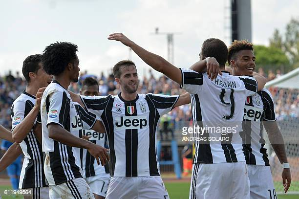 Juventus' forward from Argentina Gonzalo Higuain celebrates with teammates after scoring during the Italian Serie A football match Empoli vs Juventus...
